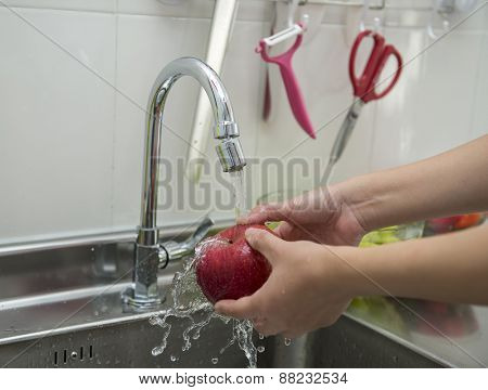 Woman hands washing apple