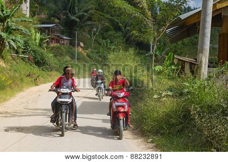 Boys Riding Motorbikes In Indonesia