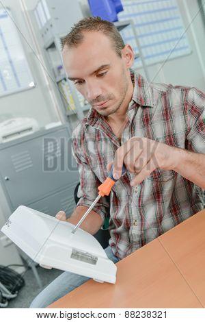 Handyman fixing an electrical appliance
