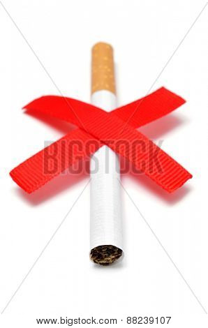 a cigarette and two crossed red slashes, depicting the concept of no smoking, on a white background