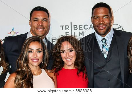 NEW YORK, NY - APRIL 16:  Tony and October Gonzalez (L), Constance Schwartz and Michael Strahan attends the premiere of 'Play It Forward' during the 2015 TFF on April 16, 2015 in New York City.