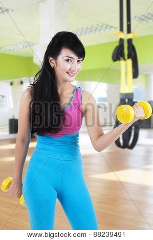 Asian Woman Exercise With Two Dumbbells