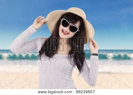 Attractive Girl With Sun glasses At Seaside