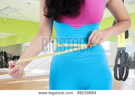 Closeup Of Woman Measure Her Belly