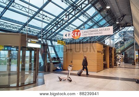 KEFLAVIK, ICELAND - March 15, 2015: Male passenger entering the Keflavik International Airport