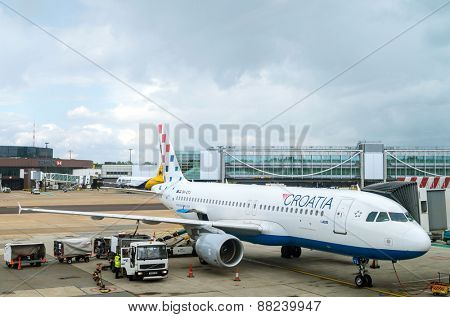LONDON, UNITED KINGDOM - March 10, 2015: Reueling Croatia Airlines' Airbus A320 on Gatwick airport in London, UK.