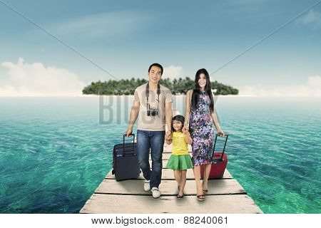 Family Arriving At The Resort Island
