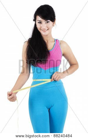 Fitness Trainer Measure Her Waist