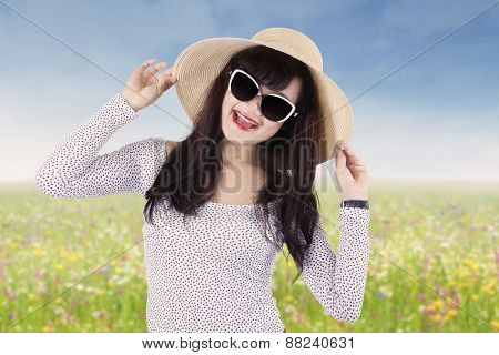 Joyful Woman With Sun glasses At Meadow