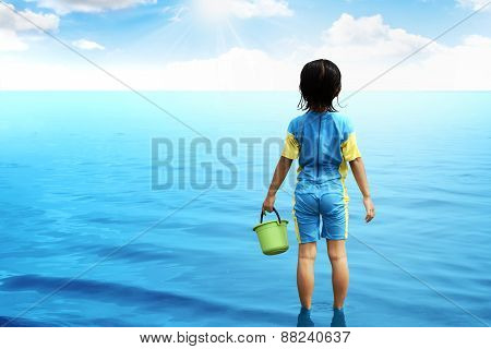 Back View Of Little Girl Looking The Ocean.