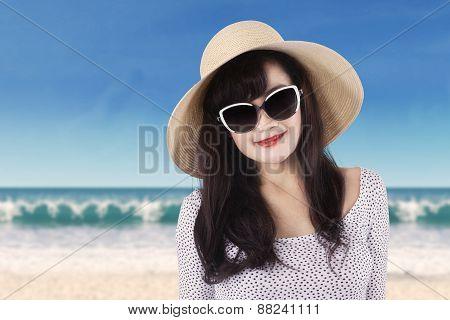Pretty Girl With Sun glasses At Coast