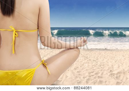 Woman With Meditating Pose At Beach