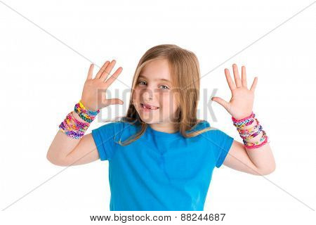 Loom rubber bands bracelets blond kid girl smiling open hands gesture on white background