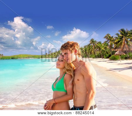 Blond couple of young tourists in a tropical summer beach palms trees in Mexico photo mount
