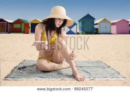 Young Model With Suntan Cream At Coast