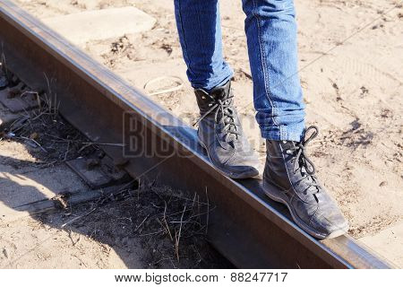 Girl legs on the railway tracks