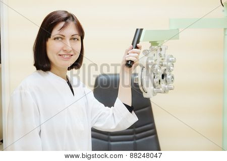 Female doctor optometrist in ophthalmology clinic