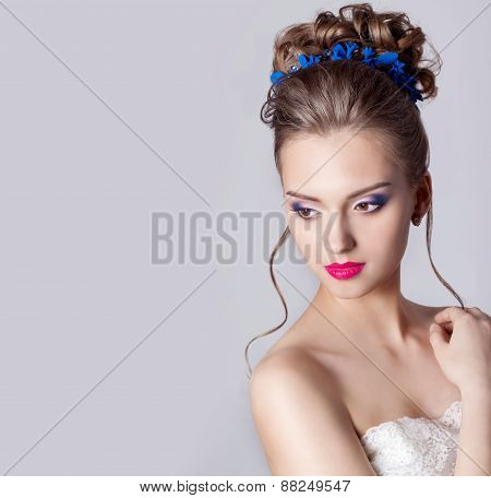fashion portrait of a beautiful attractive girl with a gentle elegant evening wedding hairstyles
