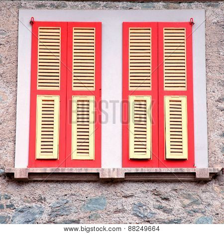 Typical Old Red Shutter Windows In Stone House, Italy.