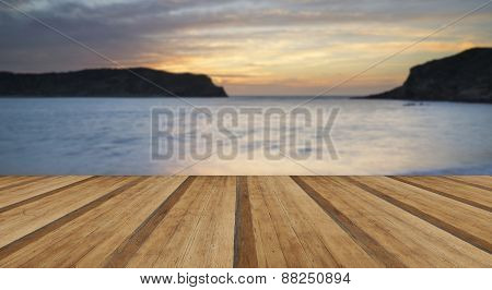 Stunning Vibrant Sunrise Landscape Over Lulworth Cove Jurassic Coast England With Wooden Planks Floo