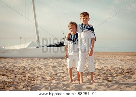 Portrait Of Young Sailors Near Yacht