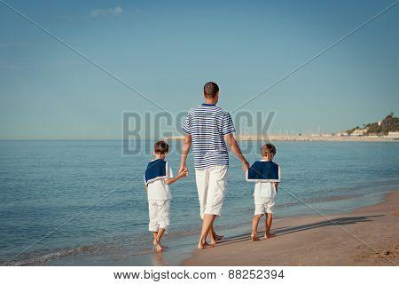 Portrait Of Happy Family Near Sea
