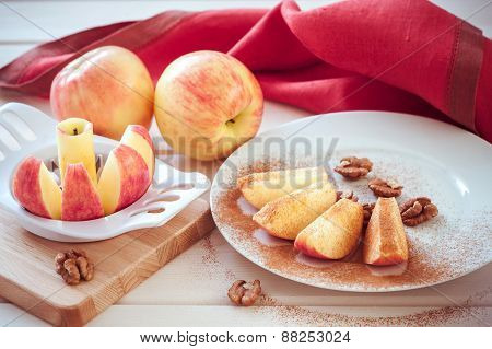 apple is sliced into wedges with cinnamon