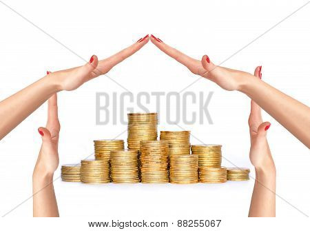 Many Coins In Columns And Woman Hands In House Form Isolated On White