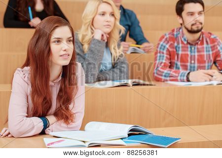Female student smiles during lecture