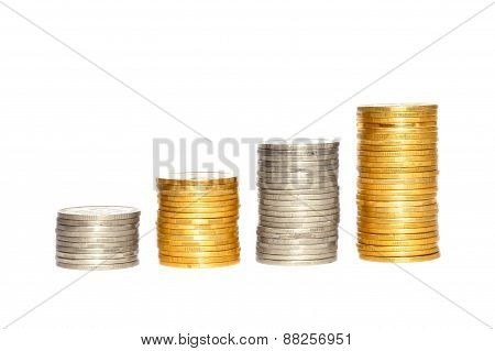 Savings, Increasing Columns Of Gold And Silver Coins Isolated On White Background