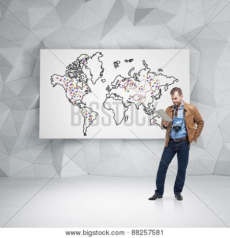 Handsome Tourist Is Examining The Map In Front Of Whiteboard
