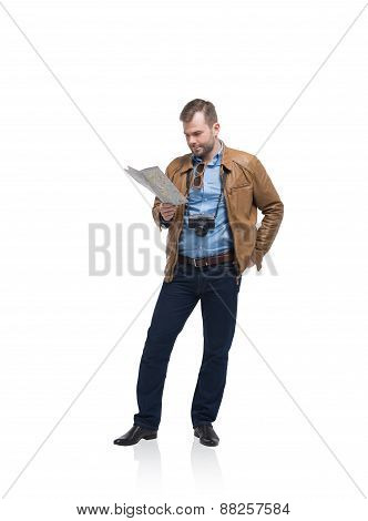 Handsome Tourist Man Is Examining The Map. Isolated