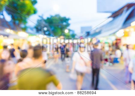 Blur Tourists Walk In Shopping Market