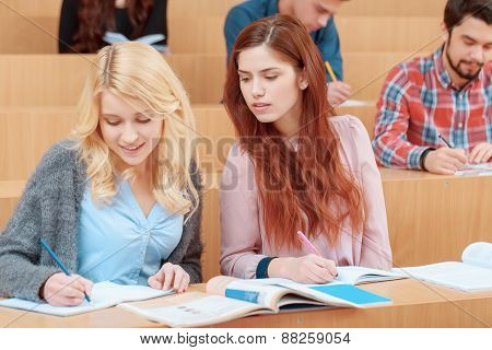 Female students study at college