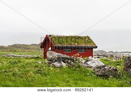 Typical red rorbu fishing hut in village , Lofoten