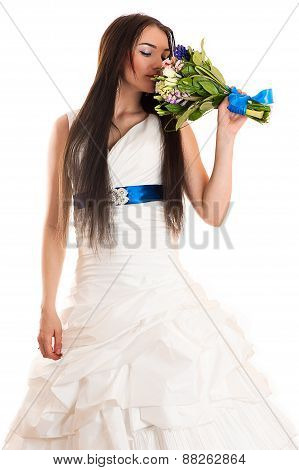 beautiful woman smelling a wedding bouquet