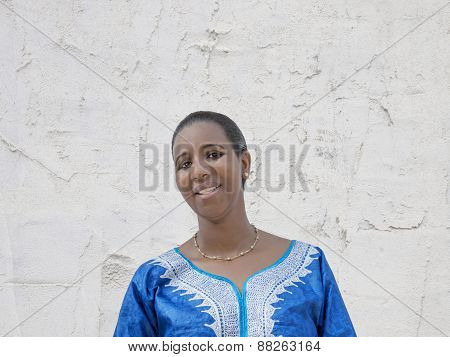 Afro beauty wearing a traditional dress in the street