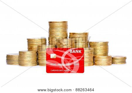 Many Coins In Column And Bank Credit Card Isolated On White