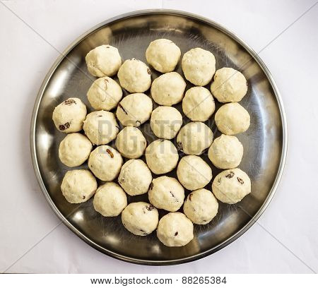 Indian sweets made from semolina, powdered sugar and clarified butter, raisins and broken almonds