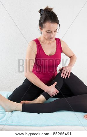 Beautiful Young Woman Getting Legs Massage