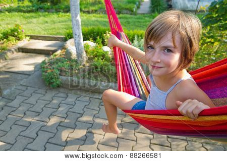 Lovely Girl Resting In A Hammock