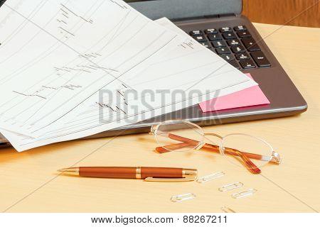 Laptop, Pen And Glasses On Office Desk