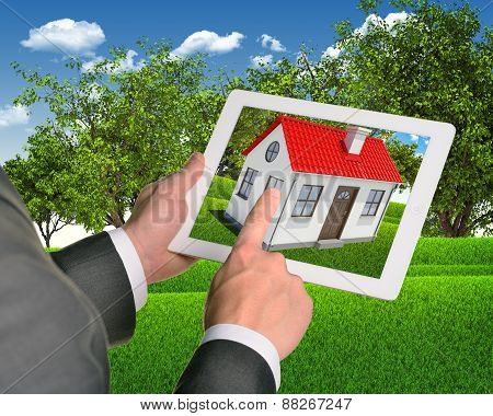 Estate agent using tablet with house on screen