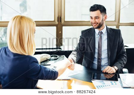 Businessman And Businesswoman Handshake In The Office