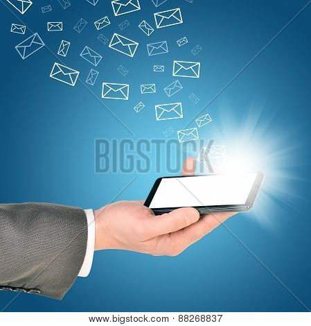 Business man using mobile phone within right hand