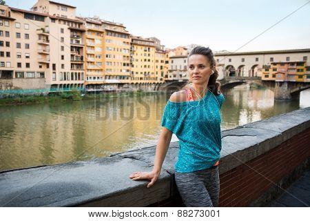 Fitness Woman Standing Near Ponte Vecchio In Florence, Italy And