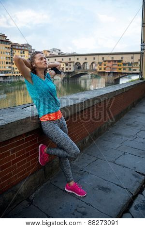 Full Length Portrait Of Relaxed Fitness Woman In Front Of Ponte Vecchio In Florence, Italy