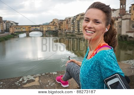 Portrait Of Happy Fitness Woman In Front Of Ponte Vecchio In Flo