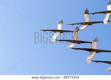 Flying Metal Cranes