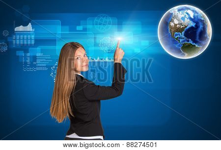 Businesswoman standing back and looking at camera pressing on holographic screen